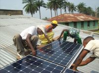 0035-Products-Household-Africa installing-solar-panels_1